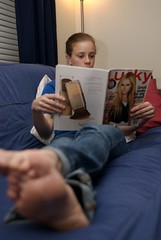 Studying - Empire (m00by) Tags: woman girl lady magazine reading couch jeans barefoot albany why futon albanyny issa uofa greatdanes sunyalbany photoservice universityatalbany dormshots empirecommons lessstudyingmorerelaxing torchpicks