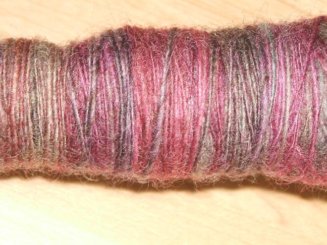 cose up of yarn on the spindle