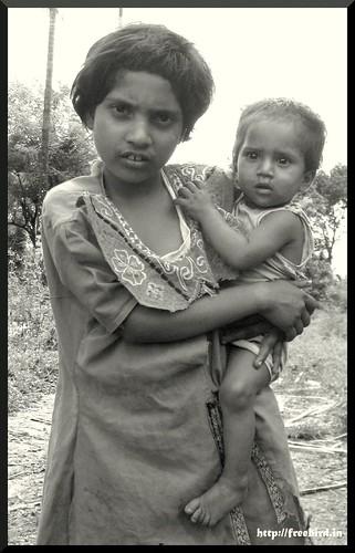 with her little brother. / കുഞ്ഞനിയനുമായി.
