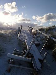 Old Trailer in Shetland (gvndwny) Tags: winter sun white snow rural countryside lensflare shetland ninians tombolo stniniansisle