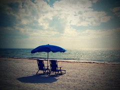 Blue Beach Scene (dyobalexander) Tags: ocean blue sea beach water bay sand surf waves chairs scene sparkle topless flickerelite