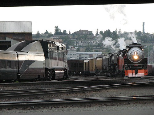 An Amtrak Cascades train meets the Portland Rose steam special