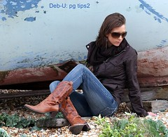 DUNGENESS (pg tips2) Tags: family england beach girl sunglasses boat kent seaside pretty slim photoshoot boots young windy pebbles jacket shore views dungeness earrings brunette modelling ona 1000 scarfe cowboyboots 1k sheltering