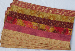leaves with mosiac mats fanned (suchprettycolors) Tags: red orange kitchen yellow gold maroon craft housewares dining patchwork placemats linens reddishorange warmtones tablerunner