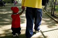 father and son (Susan NYC) Tags: park street nyc blue red playground kids children toddler little manhattan parks holdinghands fatherandson washingtonheights mws latespring parentandchild bennettpark nycparks localkids parentsandchildren youngkids littleandbig