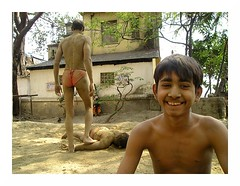 laughing | Kolkata (arnabchat) Tags: portrait india look river kid smiles explore clay kolkata bengal calcutta howrahbridge hooghly ghaat arnabchat arnabchatterjee