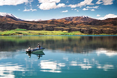 Gone fishin' (Daniel Murray (southnz)) Tags: newzealand lake reflection water landscape boat fishing scenery nz southisland aviemore supershot southnz superbmasterpiece eos50escanfromprint