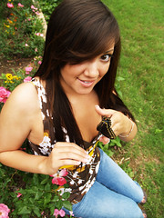 Beautiful Catch (kkelly2007) Tags: pink flowers portrait brown flower green eye nature girl grass shirt butterfly hair outside holding hands pants jeans hold unaltraperlanera