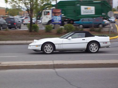 A white Corvette C4 convertible