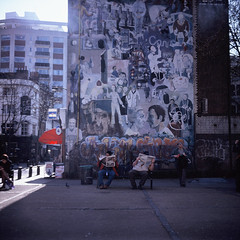 Untitled #25 (edscoble) Tags: road street sun london 120 6x6 tlr wall court lunch reading graffiti lomo camden seat slide lunchtime lubitel fujifilm rest medium format 100 provia e6 tottenham bloke 100f goodge londonist 166b