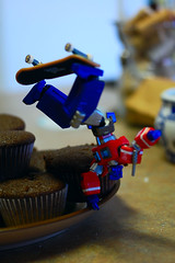 A bot and his skateboard (revlimit) Tags: macro kitchen toys prime cupcakes transformers skateboard optimus nikkor ais manuallens cuppycakes revoltech nikond40 nikkor55mm28micro 55mm28macro