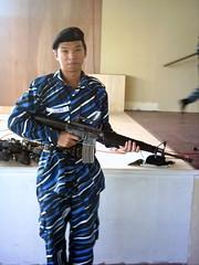 Me handling M16 rifle