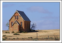 Praying for Rain... (fotofantasea) Tags: travel blue roof shadow sky orange plants brown white building tree green church window nature grass architecture composition fence landscape grey rocks exterior cross angle silverton timber bricks hill australia roadtrip frame newsouthwales outback 52 blueribbonwinner outstandingshots abigfave outstandingshot apcomp diamondclassphotographer auselite