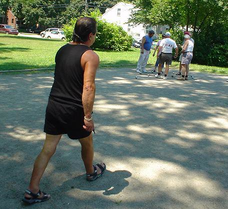 Roland walks up to the boules to see the layout
