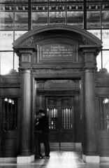 A good booke is... (cortomaltese) Tags: newyorkcity blackandwhite bw newyork us columns valentine fifthavenue publiclibrary nycset woodenwalls