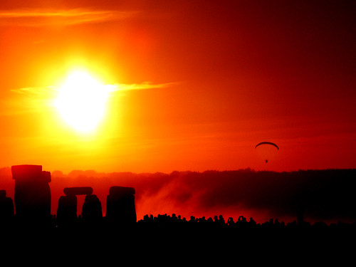 The first rays of the solstice dawn light up the ancient megaliths of Stonehenge. Man has stood here and watched this annual spectacle for more than five millenia.