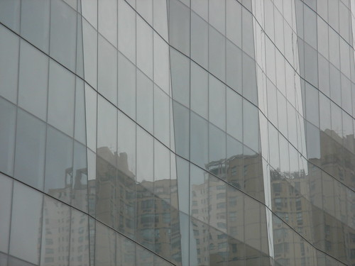 Reflections In The Glass Facade