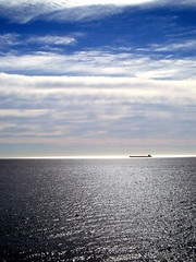 on the horizon (macca) Tags: ocean tanker woolongong horizon sky cloud water shimmer boat