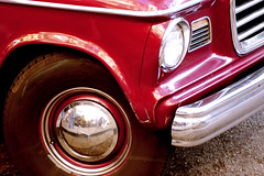 red truck on pacific avenue (jen clix) Tags: red truck tire reflection headlight bumper grill santacruz pacificavenue studebaker