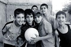 Kids in Deheisha Refugee Camp (velvetart) Tags: camp portrait blackandwhite white black kids israel football palestine westbank refugees forsakenpeople occupied palestinians globalpoverty deheisha birdpoem bestofpalestinegroup