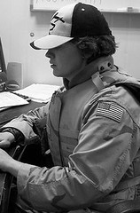 Desk Work at the Gate (tommigodwin) Tags: woman soldier war iraq baghdad veteran deployment bodyarmor