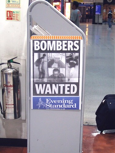 Bombers WANTED reads the news stand at Waterloo Station, London, by Bombers WANTED reads the news st