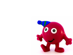 happy red man (macca) Tags: red round inanimate whiteground toy