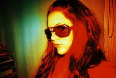 CNV00038 (emma b) Tags: 2005 june lomo lca crossprocessed xpro film e6 emma selftake colour sunglasses elvislives books leeds uk westyorkshire jessops100 coloursplash