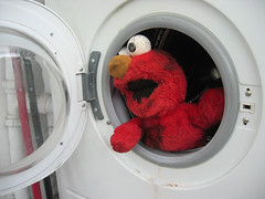 let-me-out! (estherase) Tags: door red london eye 1025fav toy toys furry findleastinteresting escape elmo fluff explore help blogged muppet washingmachine canonixus400 softtoy faved emssimp savingelmo themedoorways oneleggedelmo