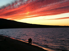 Sunset Over Superior (SpringChick) Tags: autumn sunset beach silhouette evening couple availablelight michigan captured lovers greatlakes explore blaze serendipity upperpeninsula lakesuperior unsuspecting porcupinemountains random1 porkies ontonagoncounty lsct springchickfavs debslifeblog springchickfb