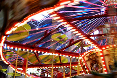 Carosel Spins (Ishrona) Tags: carnival blue motion blur 1025fav lights fantastic spin move denver explore carosel photooftheweek anythingfantastic ishrona