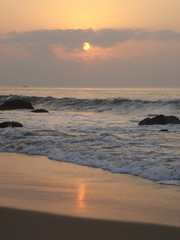 DSC00231 (Atheistbishop) Tags: beach vizag sun rise orange water shore horizon rocks