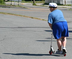 Fat kid on a scooter