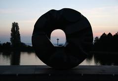 Black Hole Sunset (Crickontour) Tags: sunset sun black art 20d water statue view hole large spaceneedle canon1785f4056 blacksun noguchi 1785mm soundgarden blackholesun alexcrickcom favcol