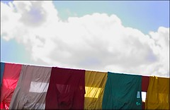 saris & blouses out to dry (puja) Tags: sky color clouds catchycolors 50mm 300d indian clothes canondigitalrebel canon50f18 50mm18 blouses canon50mm18 tenpositive