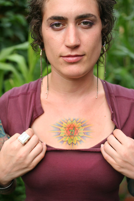 The tattoo is called 'Anahata' and it is of the heart chakra.