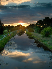 The Chaperone (Kevin Day) Tags: uk sunset england sky reflection water reeds canal interestingness topf50 topv555 topf75 perfect topv1111 interestingness1 slough berkshire kevday topf100 topv888 chaperone milked