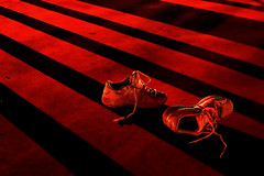 The Abandoned Pair (| HD |) Tags: sunset shadow red black 20d abandoned canon bravo shoes exercise personal stripes pair favorites like objects running more short favourites hd athlete retired favs darwish hamad bronly artlibre artsyfartsyfeet
