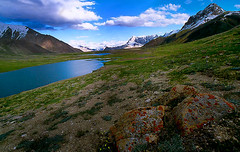 Pamir Mountains (meansmuchtome) Tags: blue pakistan sky lake snow mountains green ice beautiful grass clouds amazing rocks asia stones glacier kashmir northernareas pamir spectular shimshal