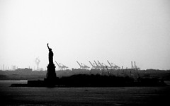 [2005] Statue of Liberty (Diego3336) Tags: ocean nyc chimney urban bw usa ny newyork monument water statue lady america port river liberty island freedom unitedstates crane unitedstatesofamerica northamerica statueofliberty seaport