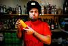 06445D4805 (Paulgi) Tags: red portrait man portugal hat bar bottle crazy europe drink juice bodylanguage bull warehouse ussr barnabe paulgi oliveiradeazemeis 4bairro