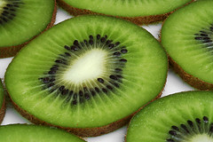 Kiwi (Sesselja Mara) Tags: hairy food color detail macro green kitchen stone closeup fruit breakfast dinner circle dessert juicy still healthy energy close natural sweet cut good juice circles decoration seed tasty fresh gourmet eat exotic health slice snack meal cutting tropical tropic diet kiwi fitness sour fruity tropics slices vitamins freshn