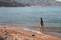 Bare Boy on Beach (hazy jenius) Tags: boy sea beach naked nude walk dahab redsea egypt middleeast free stick libre sinai