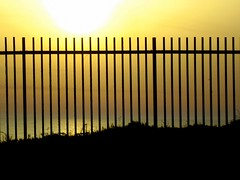 Sunset and a fence ( Nush ) Tags: camera family cliff beach fun afternoon saturday redwine breeze mika myeverydaylife hertzelia
