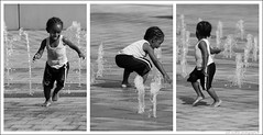 the joy of summer (s o u t h e n) Tags: trip portrait blackandwhite bw playing cute water fountain d50 fun three kid nikon downtown triptych child ryan detroit nikond50 riverfront fountains playful riverwalk 2007 motown motorcity southen ryansouthen 1on1peoplephotooftheday 1on1peoplephotoofthedayjune2007