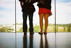 taking in the view at the de young (lomokev) Tags: sanfrancisco california goldengatepark wood trees people sexy green feet window glass deyoungmuseum roc madera couple floor legs low ground skirt contax deyoung agfa holz ultra t2 agfaultra contaxt2 ratseyeview sanfrancisco2007 rota:type=showall rota:type=portraits rota:type=cityscape file:name=070316contaxt286  rota:type=swap