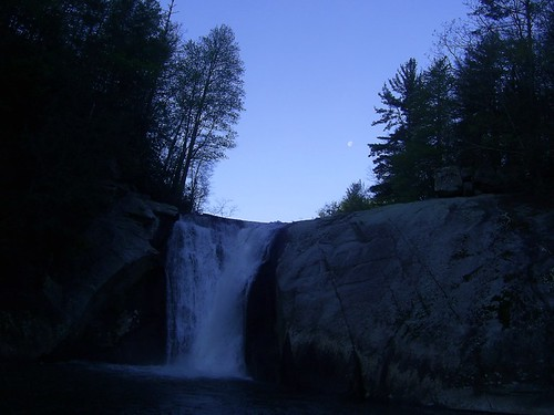 waning moon over waterfall