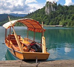 Naptime on Lake Bled (Jason's Travel Photography) Tags: people lake castles water boats searchthebest slovenia bled soe blueribbonwinner outstandingshots mywinners abigfave shieldofexcellence anawesomeshot colorphotoaward impressedbeauty travelerphotos diamondclassphotographer superhearts jasonstravel
