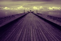 Clevedon Pier (duotone) (Nigel Dourley) Tags: wood old uk sea england cloud water monochrome canon bristol coast pier wooden seaside europe perspective sigma somerset historic explore duotone planks clevedon 1770mm 400d nigeldourley cornishphotographer