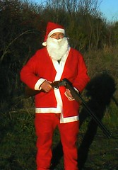 santa  and his gun